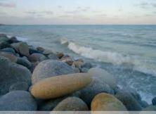 Basalt rocks by lake