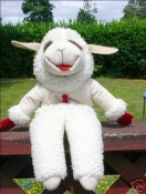 Picture of Shari Lewis' Lambchop puppet, sitting on a picnic table and smiling.