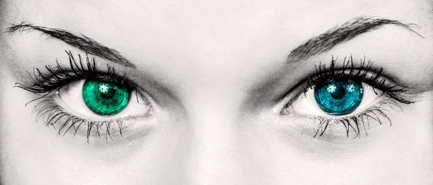 Woman's eyes: one blue, one green
