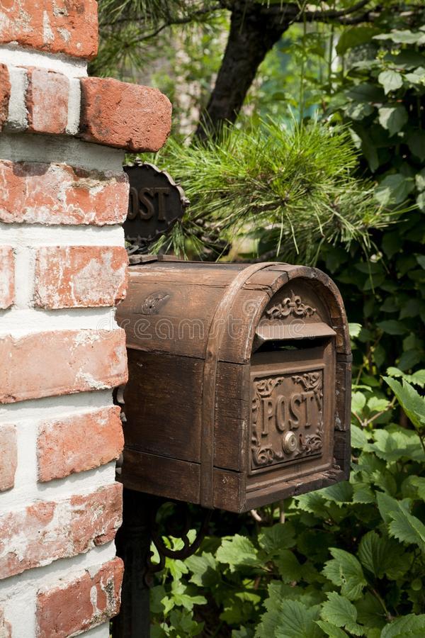 mailbox by brick wall