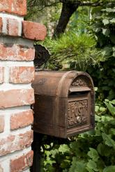 mailbox by brick wall