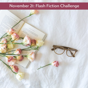 pink rosebuds and reading glasses scattered over an open book