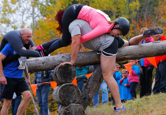 Wife carrying Competition, jumping a hurdle