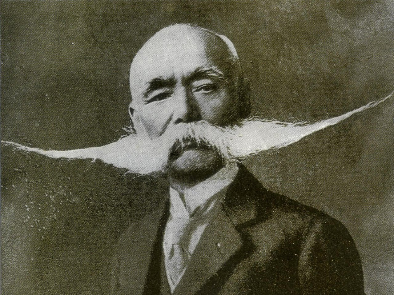 Man with an incredibly wide mustache
